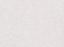 Bakgrund från vit grov kanfastextur Arkivfoto
