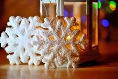 Bakgrund för flinga för snö för vinterferie, Bokeh Arkivfoto