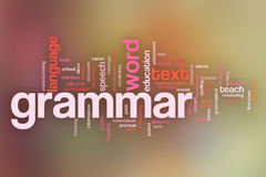 Bakgrund för moln för grammatikbegreppsord på pastellfärgad suddig backgrou Arkivbild