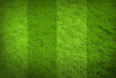 Bakgrund för textur för grönt gräs för fotbollfotboll Royaltyfri Fotografi