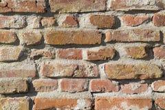 Bakgrund gammal murverktegelstenvägg Arkivbilder