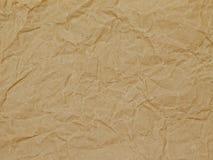 Bakgrund inpackningspapper, textur, brunt, skrynkla Royaltyfri Foto