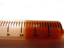 bakgrund isolerad injektionsspruta Arkivfoton