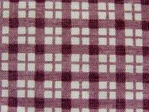 bakgrund kontrollerad textil Arkivbilder