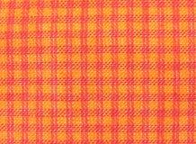bakgrund kontrollerad textil Arkivbild