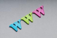 bakgrund letters www Royaltyfri Foto