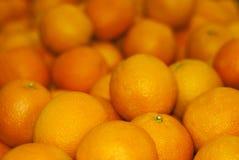 Bakgrund - ljusa orange apelsiner Arkivfoton