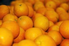 Bakgrund - ljusa orange apelsiner Arkivbild