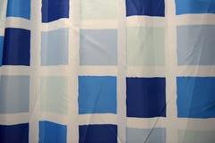 Bakgrund med blåa fyrkanter Fotografering för Bildbyråer
