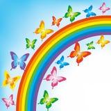 Bakgrund med fjärilen och regnbågen Arkivfoto