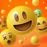 Bakgrund med gruppen av smileyemoticons Arkivfoton