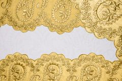 Bakgrund med guld- modeller arkivbilder