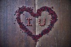 Bakgrund med text älskar jag dig för valentins dag Arkivfoto