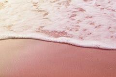 Bakgrund Mjuk havsvåg på sanden tonat foto Arkivfoton