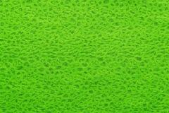 Bakgrund och textur av tyg av ljust - grön färg Arkivbild