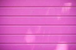 Bakgrund rosa vägg Arkivfoto