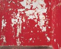 Bakgrund skalad röd målarfärg på väggen Royaltyfri Foto