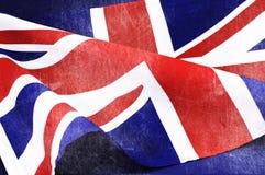 Bakgrund som är nära upp av den brittiska Union Jack flaggan för Storbritannien Arkivfoton
