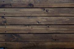 bakgrund som stiger ombord inomhus trä för brunt fragment Fotografering för Bildbyråer