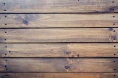bakgrund som stiger ombord inomhus trä för brunt fragment Arkivfoton