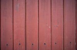 bakgrund som stiger ombord inomhus trä för brunt fragment Bultat spikar arkivfoton