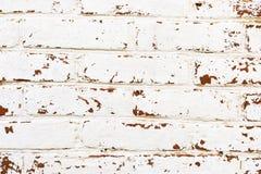 Bakgrund - tegelstenvägg med vit målarfärg eller murbruk för skalning Arkivfoto