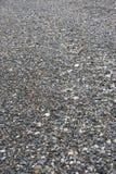 Bakgrund, textur av havskiselstenar på stranden av det olika formatet och färg Royaltyfria Foton