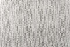 Bakgrund textur - yttersida av ett ull stuckit tygslut upp royaltyfri bild