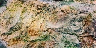 Bakgrund Texturen av den naturliga stenen royaltyfri foto