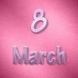 Bakgrund till de internationella kvinnornas dag i rosa färger Arkivfoto