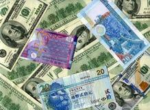 Bakgrund US dollar och HK-dollar Arkivfoto