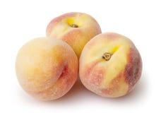bakgrund vita isolerade persikor Arkivbild