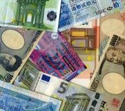 Bakgrund Yen, euro och HK-dollar Royaltyfri Fotografi