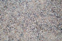 Bakgrunden av den gråa byggande sanden arkivbild