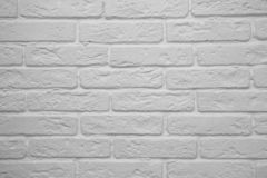 Bakgrunden av den vita tegelstenväggen arkivfoto