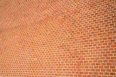 Bakgrunden av väggen av röd tegelsten med perspektiv arkivfoto