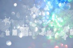 Bakgrunder för juldag med blåa bokehbakgrunder Royaltyfri Bild