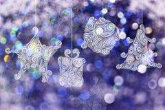 Bakgrunder för juldag med purpurfärgade bokehbakgrunder Arkivfoton