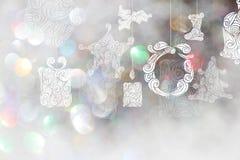 Bakgrunder för juldag med vita bokehbakgrunder Arkivbild