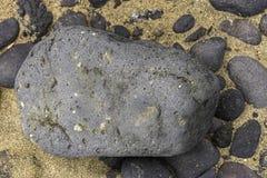 Bakgrunder med sand och stenar royaltyfria foton