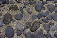 Bakgrunder med sand och stenar royaltyfria bilder