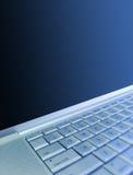 bakgrundsbärbar dator Arkivbild