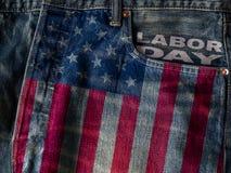 Bakgrundsbegrepp för arbets- dag USA flagga på wi för jeansgrov bomullstvilltextur Royaltyfri Bild