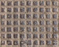 Bakgrundsbeiga, brun stentegelplattafyrkant, beläggning som avslutar sig Royaltyfri Foto