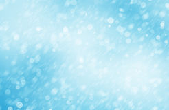 Bakgrundsbild med blåa bokehljus av snö Arkivbild