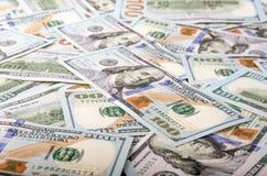 bakgrundsdollarexponeringsglas isolerade white för pengar s u för lås förstorande S dollar för 100 bill Arkivfoton