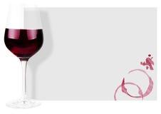 bakgrundsexponeringsglasrött vin Arkivbild