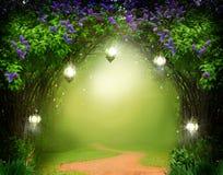 bakgrundsfantasitext skriver ditt Magisk skog med vägen royaltyfri foto