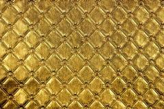 bakgrundsfilt av guld- Fotografering för Bildbyråer