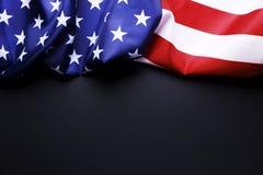 Bakgrundsflagga av Amerikas förenta stater för nationell federal ferieberöm och sörjande minnedag USA symbol Arkivbilder